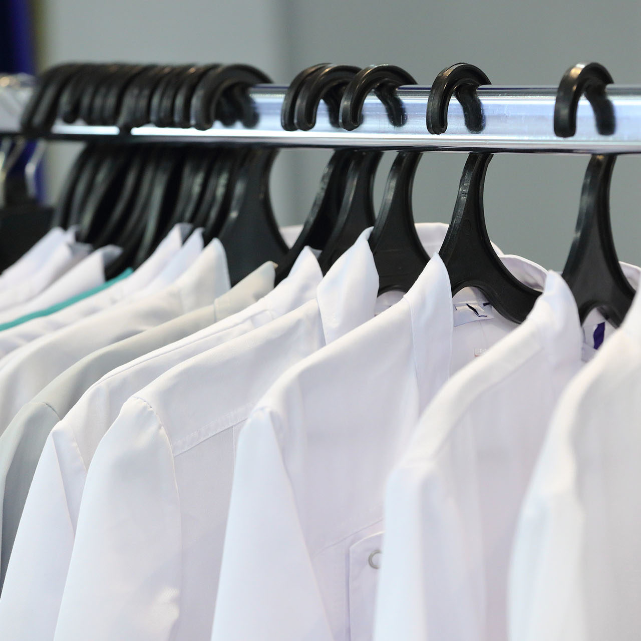 Medical uniform on a hangers in a shop